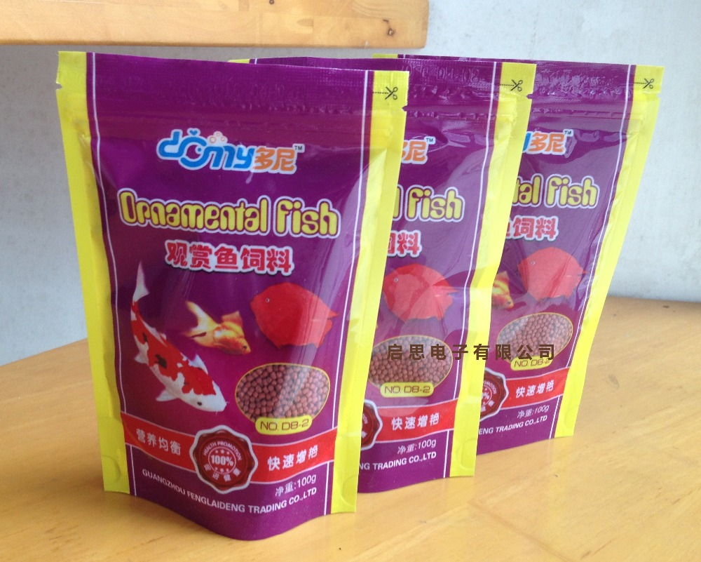 Goldfish/Golden carps/Red Parrot/omamental fish food enriched Protein Fat Calcium Phosphprus food 100G Pet food(China (Mainland))